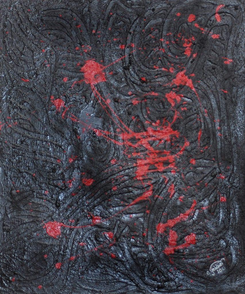 Sandspiel in Rot und Schwarz